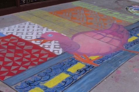 Anastasia Varykoni, 12th grader, completed her last year of painting on the pavement.