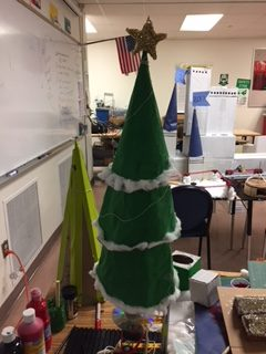 An image of the Christmas Tree mechanism of first period POE and in the backdrop Period 2 Cinderella's castle both for Winter Wonderland.